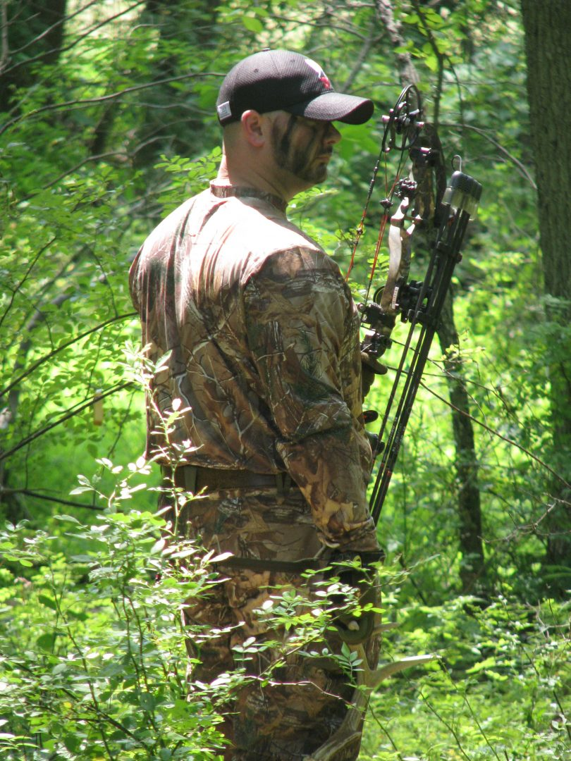 Bow hunter in the woods, hunting t-shirts, women's, ladies archery apparel, hunting apparel and accessories, Faith based